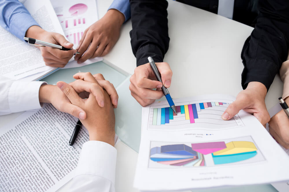 Close-up shot of an analytical team working with the latest financial results